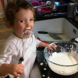 Lizey helping with the cooking... eating the cream off the whisk